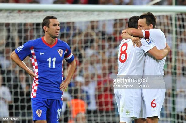 England's Frank Lampard celebrates scoring his sides third goal of the game with teammate John Terry as Croatia's Darijo Srna stands dejected