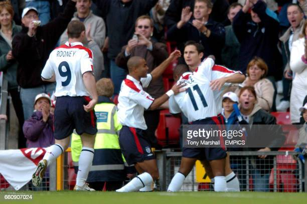 England's Frank Lampard celebrates scoring the opening goal against Wales with Wayne Rooney Ashley Cole and Jermain Defoe