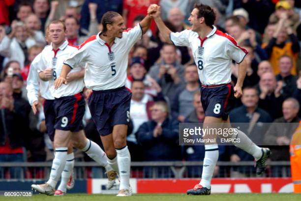 England's Frank Lampard celebrates scoring the opening goal against Wales with Rio Ferdinand as Wayne Rooney looks on