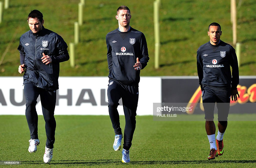 England's Frank Lampard (L), Gary Cahill (C) and Theo Walcott (R) take part in a team training session at St George's Park in central England, on February 4, 2013. England take on Brazil at London's Wembley stadium in an international friendly on February 6. AFP PHOTO/Paul Ellis USE