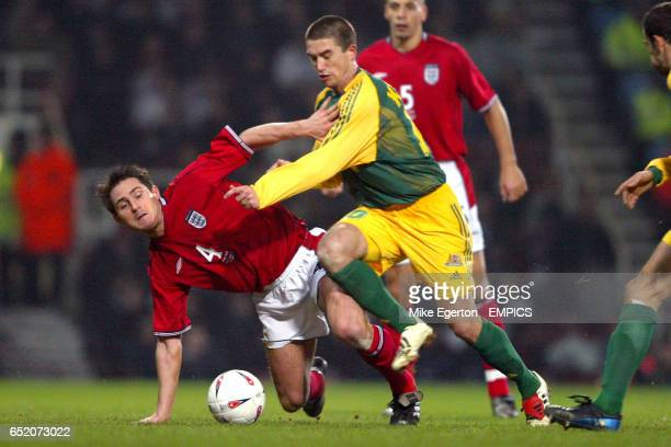 England's Frank Lampard tumbles to the ground as Australia's Harry Kewell goes for the ball