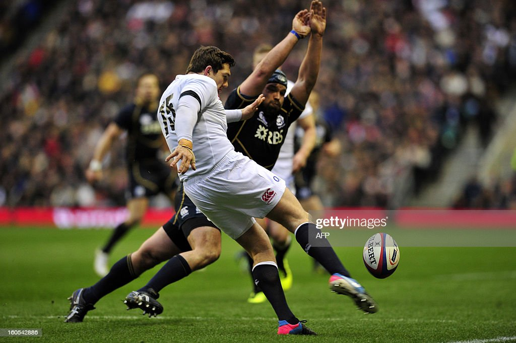 England's full back Alex Goode clears the ball during the 6 Nations international rugby union match between England and Scotland at Twickenham Stadium, southwest of London on February 2, 2013. England won the game 38 - 18.