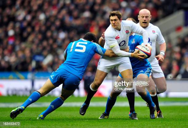 England's full back Alex Goode is tackled by Italy's full back Andrea Masi during the Six Nations international rugby union match between England and...