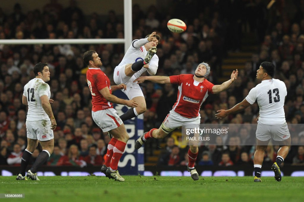 England's full back Alex Goode (C) jumps for the ball during the Six Nations international rugby union match between Wales and England at the Millennium Stadium in Cardiff, south Wales on March 16, 2013. Wales won 30 - 3.