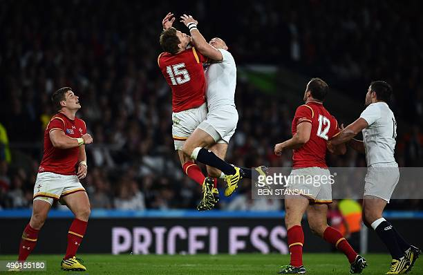 England's fullback Mike Brown and Wales' fullback Liam Williams jump for the ball during a Pool A match of the 2015 Rugby World Cup between England...