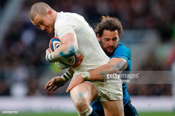 TOPSHOT England's fullback Mike Brown is tackled by Italy's centre Michele Campagnaro during the Six Nations international rugby union match between...