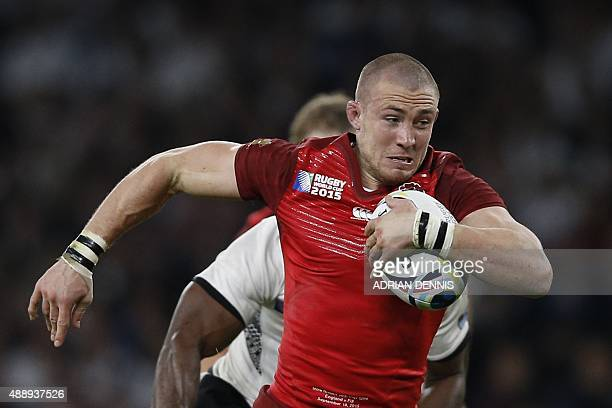 England's fullback Mike Brown runs witht he ball during a Pool A match of the 2015 Rugby World Cup between England and Fiji at Twickenham stadium in...
