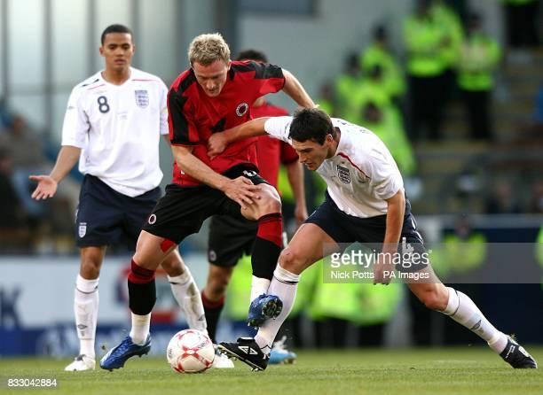 England's Gareth Barry and Albania's Besart Berisha battle for the ball