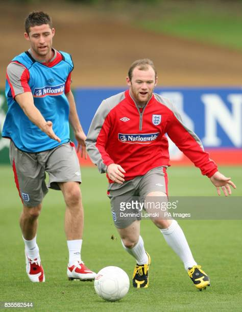 England's Gary Cahill and Wayne Rooney during a training session at London Colney Hertfordshire