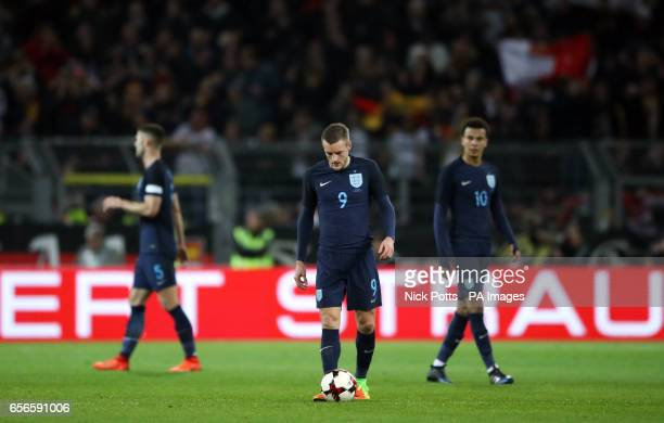 England's Gary Cahill Jamie Vardy and Dele Alli stand dejected during the International Friendly match at Signal Iduna Park Dortmund