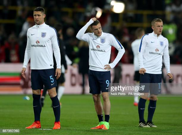 Englands Gary Cahill Jamie Vardy and James WardProwse warm up prior to the match