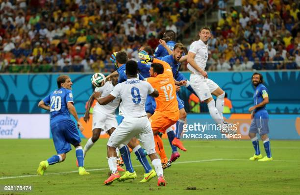 England's Gary Cahill jumps in the penalty area with goalkeeper Italy's Salvatore Sirigu during the FIFA World Cup Group D match at the Arena da...