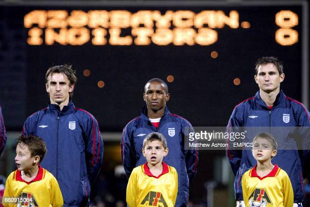England's Gary Neville Jermain Defoe and Frank Lampard line up prior to the game