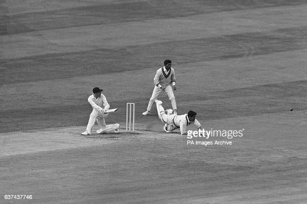 England's Geoff Boycott sweeps the ball past diving India wicketkeeper Farokh Engineer