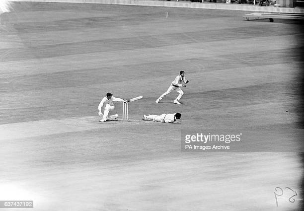 England's Geoff Boycott watches the ball run to the boundary after he swept it past India wicketkeeper Farokh Engineer