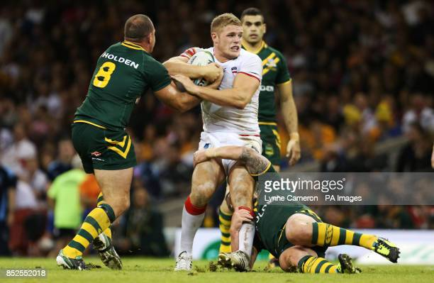 England's George Burgess is tackled by Australia's Matthew Scott and Cooper Cronk during the 2013 World Cup match at the Millennium Stadium Cardiff