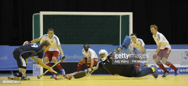 England's George Pinner dives at Adam MacKenzies' shot at goal during their Indoor International test at the NIA Birmingham7th December 2009