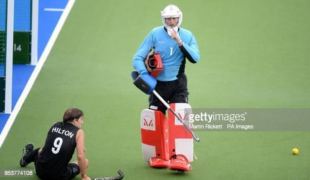 England's George Pinner makes a save from New Zealand's Blair Hilton in the bronze medal game at the National Hockey Centre during the 2014...