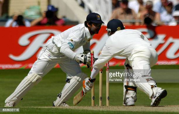 England's Geraint Jones is bowled by Sri Lanka's Muttiah Muralitharan and stumped by Kumar Sangakkara for 19 runs during second day of the Third...