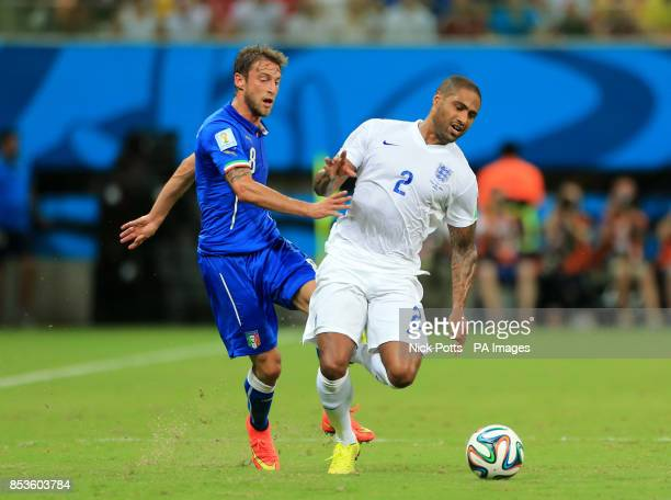 England's Glen Johnson and Italy's Claudio Marchisio battle for the ball during the FIFA World Cup Group D match at the Arena da Amazonia Manaus...