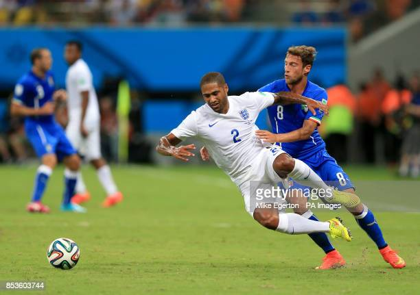 England's Glen Johnson battles for the ball with Italy's Claudio Marchisio during the FIFA World Cup Group D match at the Arena da Amazonia Manaus...