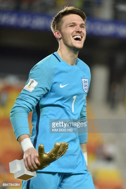 England's goalkeeper Freddie Woodman celebrates with his trophy during the awards ceremony after winning the U20 World Cup final football match...