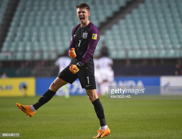 England's goalkeeper Freddie Woodman reacts after teammate Ademola Lookman scored during their U20 World Cup round of 16 football match between...