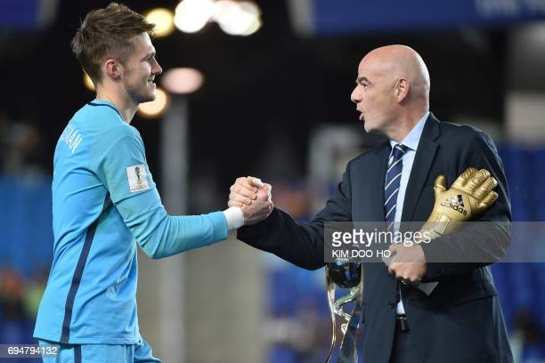 England's goalkeeper Freddie Woodman recieves a trophy during the awards ceremony after winning the U20 World Cup final football match between...