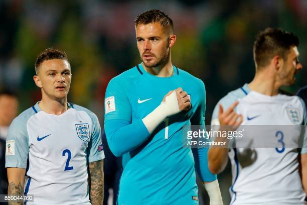 England's goalkeeper Jack Butland and England's defender Kieran Trippier leaves the pitch after the final whistle during the 2018 FIFA World Cup...