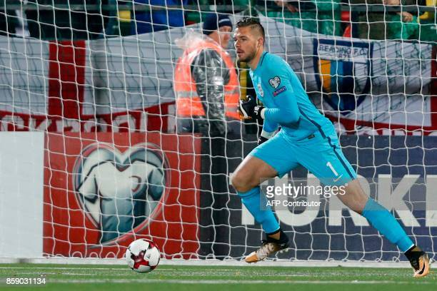England's goalkeeper Jack Butland controls the ball at his feet during the 2018 FIFA World Cup European Qualifying football match between Lithuania...