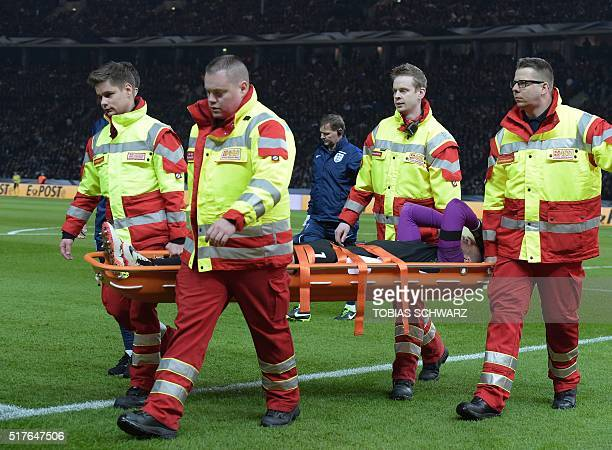 England's goalkeeper Jack Butland is carried off on a stretcher during the friendly football match Germany v England at the Olympic Stadium in Berlin...
