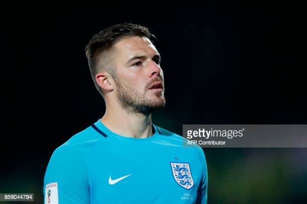 England's goalkeeper Jack Butland leaves the pitch after the final whistle during the 2018 FIFA World Cup European Qualifying football match between...