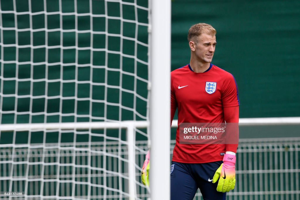 CORRECTION - England's goalkeeper Joe Hart attends a training session at the Bourgogne stadium in Chantilly on June 26, 2016, during the Euro 2016 football tournament. / AFP / MIGUEL MEDINA / The erroneous mention[s] appearing in the metadata of this photo by MIGUEL MEDINA has been modified in AFP systems in the following manner: [at the Bourgogne stadium in Chantilly] instead of [at the team's training ground in Montpellier]. Please immediately remove the erroneous mention[s] from all your online services and delete it (them) from your servers. If you have been authorized by AFP to distribute it (them) to third parties, please ensure that the same actions are carried out by them. Failure to promptly comply with these instructions will entail liability on your part for any continued or post notification usage. Therefore we thank you very much for all your attention and prompt action. We are sorry for the inconvenience this notification may cause and remain at your disposal for any further information you may require.