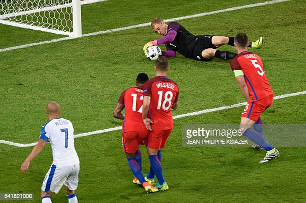 TOPSHOT England's goalkeeper Joe Hart dives for the ball during the Euro 2016 group B football match between Slovakia and England at the...