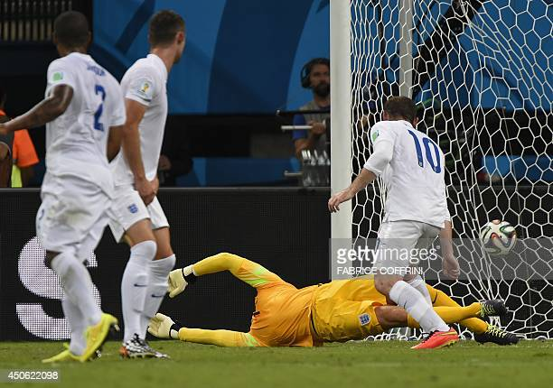 England's goalkeeper Joe Hart fails to save the ball during a Group D football match between England and Italy at the Amazonia Arena in Manaus during...