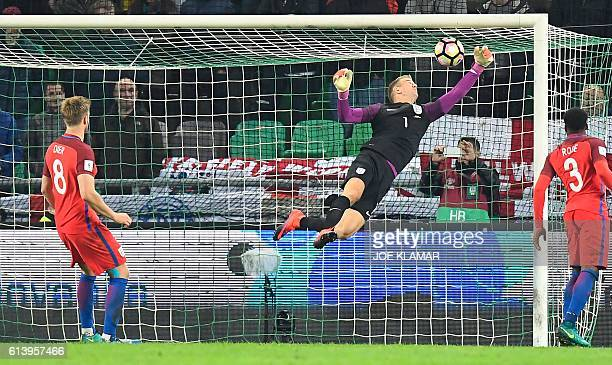 England's goalkeeper Joe Hart makes a saveduring the Fifa World Cup 2018 football qualification match between Slovenia and England in Ljubljana on...