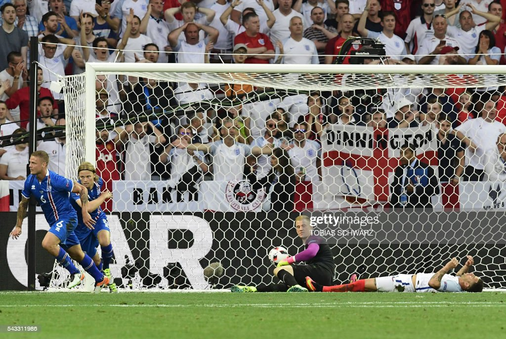 England's goalkeeper Joe Hart misses the ball to give Iceland their first goal during Euro 2016 round of 16 football match between England and Iceland at the Allianz Riviera stadium in Nice on June 27, 2016. / AFP PHOTO / TOBIAS SCHWARZ / The erroneous mention[s] appearing in the metadata of this photo by TOBIAS SCHWARZ has been modified in AFP systems in the following manner: [England's goalkeeper Joe Hart misses the ball to give Iceland ] instead of [Iceland's goalkeeper Hannes Thor Halldorsson misses the ball to give England their first goal]. Please immediately remove the erroneous mention[s] from all your online services and delete it (them) from your servers. If you have been authorized by AFP to distribute it (them) to third parties, please ensure that the same actions are carried out by them. Failure to promptly comply with these instructions will entail liability on your part for any continued or post notification usage. Therefore we thank you very much for all your attention and prompt action. We are sorry for the inconvenience this notification may cause and remain at your disposal for any further information you may require.