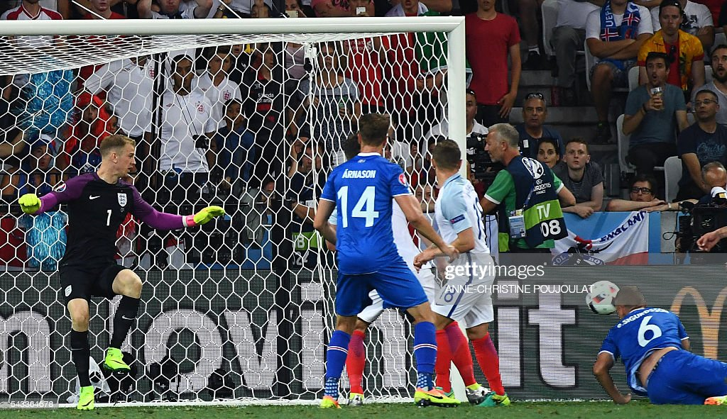 England's goalkeeper Joe Hart (L) saves a ball shot by Iceland's defender Ragnar Sigurdsson (R) during Euro 2016 round of 16 football match between England and Iceland at the Allianz Riviera stadium in Nice on June 27, 2016. / AFP / ANNE