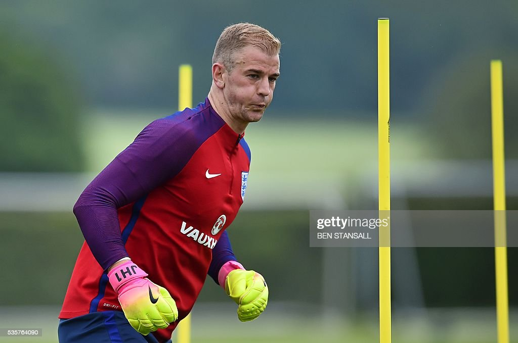 England's goalkeeper Joe Hart takes part in a team training session in Watford, north of London, on May 30, 2016. England play against Portugal in a friendly match at London's Wembley Stadium on Thursday June 2, 2016. / AFP / BEN