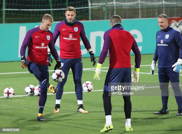 England's goalkeepers Joe Hart Jack Butland and Jordan Pickford take part in a training session on the eve of the 2018 FIFA World Cup Qualifying...