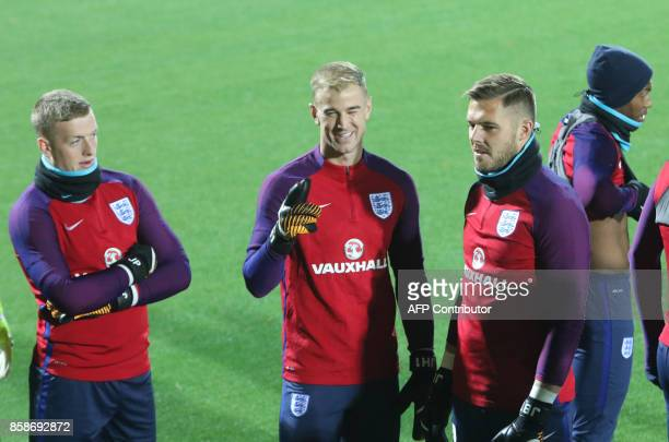 England's goalkeepers Jordan Pickford Joe Hart and Jack Butland take part in a training session on the eve of the 2018 FIFA World Cup Qualifying...