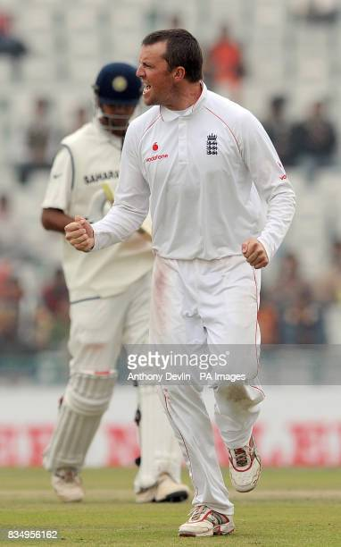 England's Graeme Swann celebrates after Rahul Dravid is caught by Monty Panesar for 136 during the second day of the second test at the Punjab...
