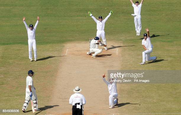 England's Graeme Swann celebrates taking the wicket of Gautam Gambhir LBW during the second day of the First Test Match at the M A Chidambaram...