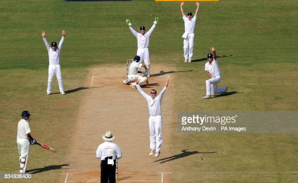 England's Graeme Swann celebrates taking the wicket of India's Gautam Gambhir LBW during the second day of the First Test Match at the M A...