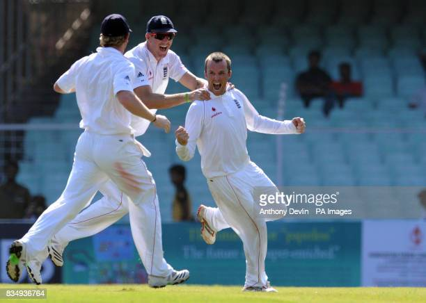 England's Graeme Swann celebrates taking the wicket of India's Rahul Dravid during the second day of the First Test Match at the M A Chidambaram...