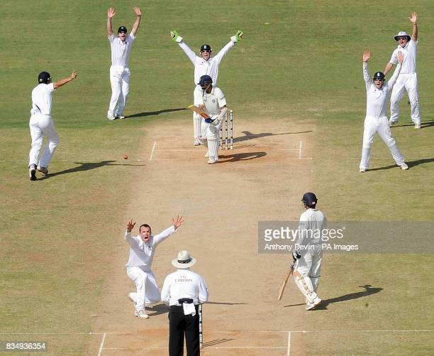England's Graeme Swann celebrates taking the wicket of Rahul Dravid during the second day of the First Test Match at the M A Chidambaram Stadium in...