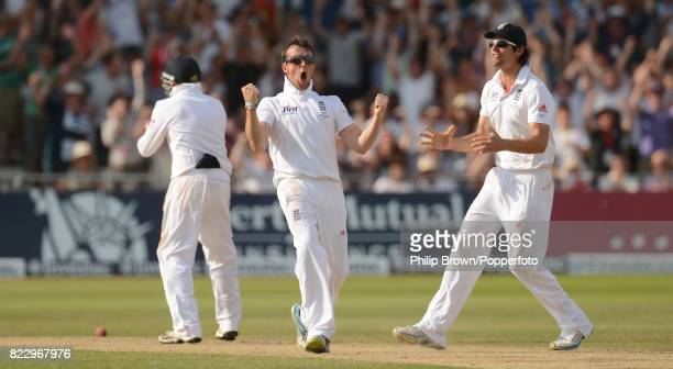 England's Graeme Swann celebrates the dismissal of Australia's Steve Smith with teammates Ian Bell and Alastair Cook during the 1st Test match...