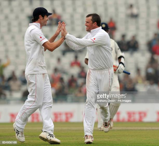 England's Graeme Swann celebrates with James Anderson after Rahul Dravid is caught by Monty Panesar for 136 during the second day of the second test...