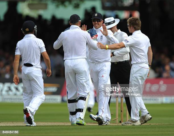 England's Graeme Swann celebrates with Matt Prior after taking South Africa's final wicket of Vernon Philander during the Third Investec Test Match...