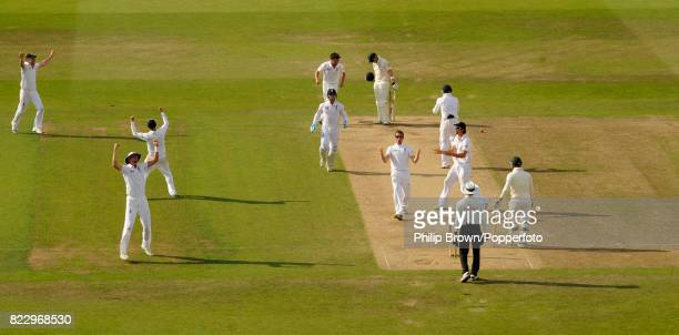 England's Graeme Swann gets the wicket of Australia's batsman Steve Smith LBW for 17 runs in the 1st Test match between England and Australia at...